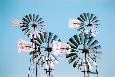 A quartet of windmills made by The American West Windmill Co. Amarillo, TX.  These are on display also at the Wind Power Center. bsg