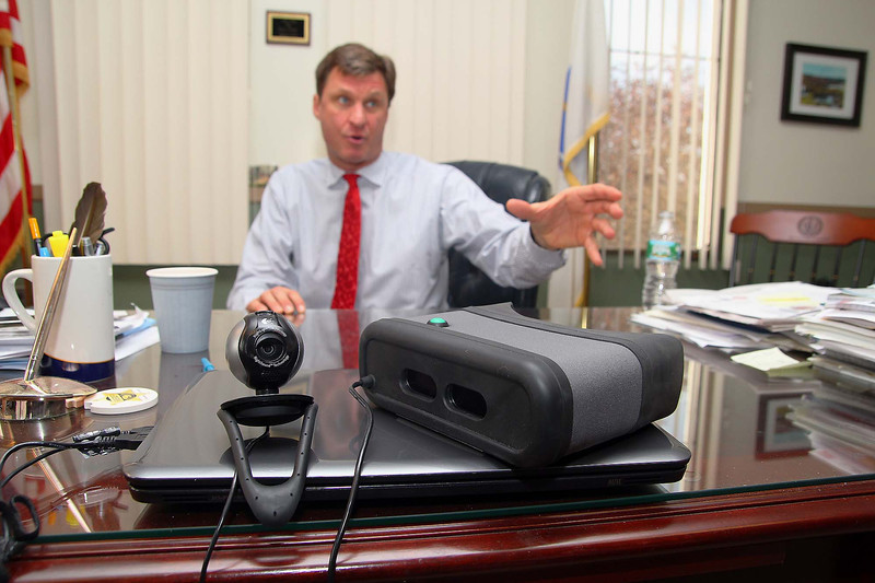 Worcester County Sheriff Lewis G. Evangelidis talks about the new Iris scanners they will be using to identify children and seniors unable to communicate who they are at his office on Friday afternoon. SENTINEL & ENTERPRISE/ JOHN LOVE