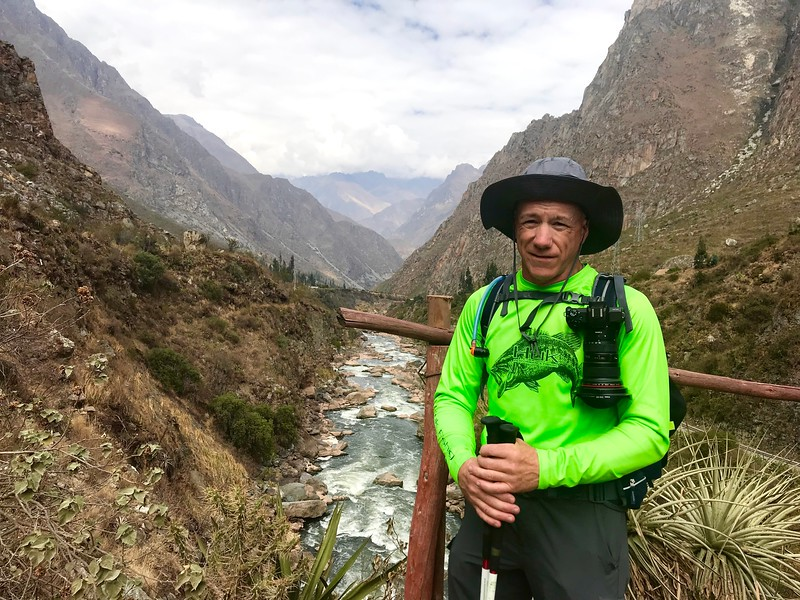 """Day 1. Here I am at Km 82, Llactapata- Ayapata. At this point, I just hope that I have packed everything I need for the four day adventure. My backpack weighs about twenty-two pounds. Water is heavier than one thinks.  To get to this starting place, I had to make reservations for this trip a year in advance. The Peruvian government restricts Inca Trail permits to a small number and they sell-out quickly. I also had to be vaccinated for TDaP, Hep A/B (which is a series of three injections), Yellow Fever, Influenza, and took medication for Malaria. Rabies was suggested, and i respectfully declined. The fight from DFW to Lima, Peru was about eight hours, with a two hour layover, before flying forty minutes on a smaller plane to Cusco. For those that might be considering this trip, the two hour layover in Lima was not enough time. Had I not met an """"angel"""" at the ticket counter in Lima, I would have missed my flight to Cusco. The Lima airport is in the stone ages compared to DFW."""