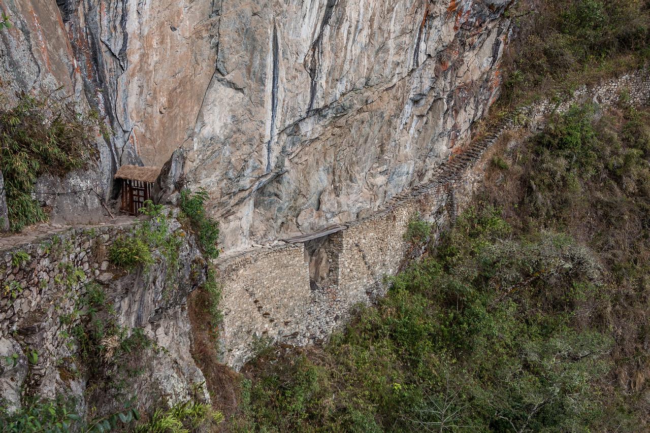 The narrow ledge of the Incan bridge at Machu Picchu