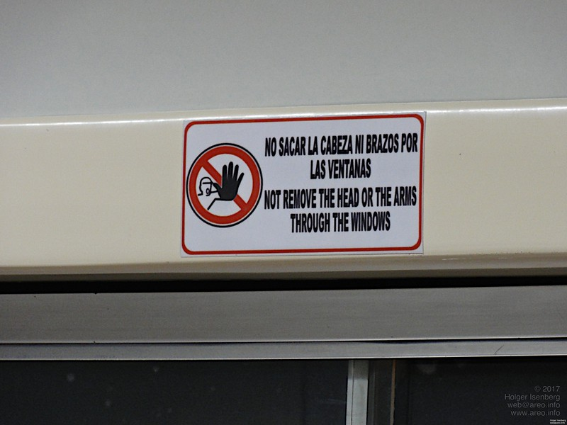 """Not remove the head or the arms through the windows"". Everyone really reads that warning text and remembers it, so the message gets transfered really efficiently."