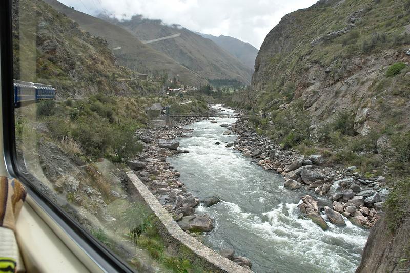 The narrow gauge track (914mm) begins at 3500m at Cusco, joins the Rio Urubamba near Ollantaytambo and follows it downstream to Aguas Calientes (Hot Springs) at 2040m.