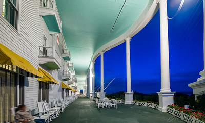 The Grand Hotel at night with a view along the porch.