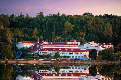 Mackinac Island - Mission Point Resort taken off shore at sunrise as the sun begins to hit the higher parts of the island