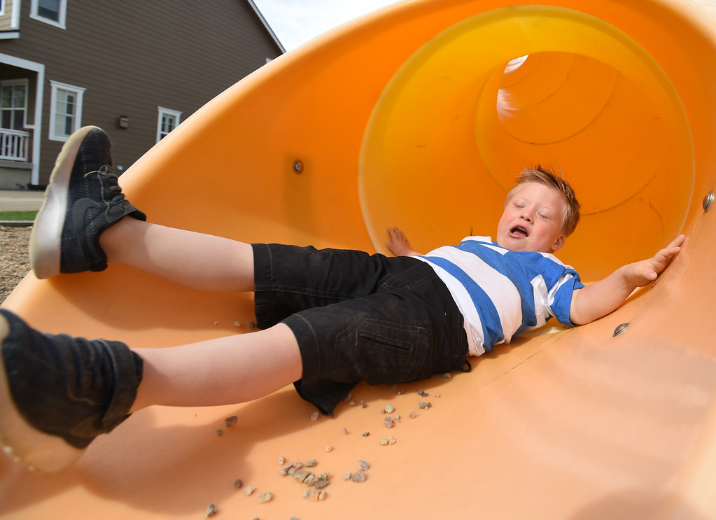 . Look out below. Macklin Steffen slides down a slide in a park near his home in Longmont.  Macklin Steffen, 4, has Down syndrome. Recently he began getting work as a model, helping to break down barriers for other kids like him. He\'s worked for the ezpz studio in Parker modeling the ezpz Happy Mat; he has modeled the Hi Little One�s color your own T-shirt; and he has modeled goldbug�s everUP socks.   Cliff Grassmick  Staff Photographer May 25, 2017