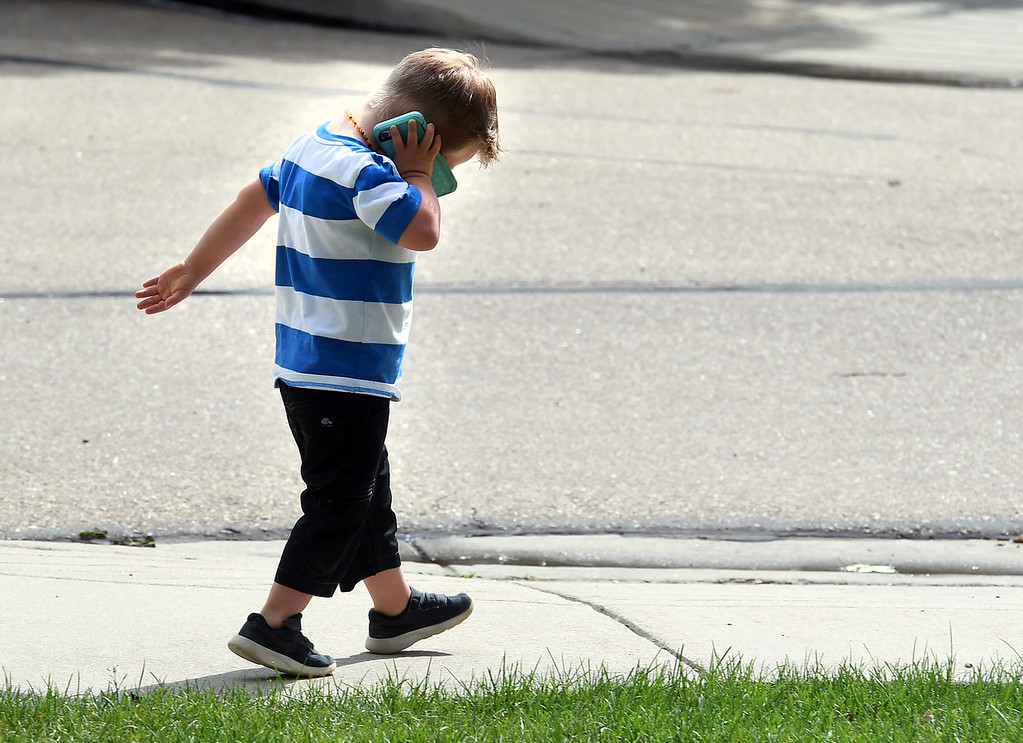 . Macklin Steffen pretends to take a call on his mother\'s cell phone  in a park near his home in Longmont.  Macklin Steffen, 4, has Down syndrome. Recently he began getting work as a model, helping to break down barriers for other kids like him. He\'s worked for the ezpz studio in Parker modeling the ezpz Happy Mat; he has modeled the Hi Little One�s color your own T-shirt; and he has modeled goldbug�s everUP socks.   Cliff Grassmick  Staff Photographer May 25, 2017