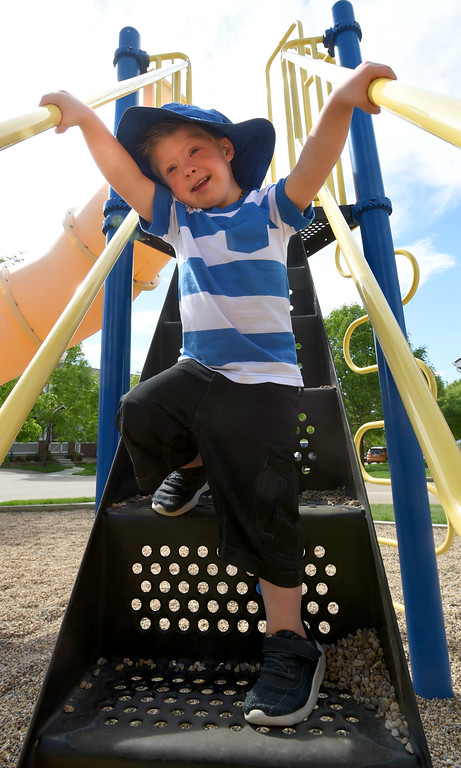 . Macklin Steffen plays with his mother in a park near his home in Longmont.  Macklin Steffen, 4, has Down syndrome. Recently he began getting work as a model, helping to break down barriers for other kids like him. He\'s worked for the ezpz studio in Parker modeling the ezpz Happy Mat; he has modeled the Hi Little One�s color your own T-shirt; and he has modeled goldbug�s everUP socks.   Cliff Grassmick  Staff Photographer May 25, 2017