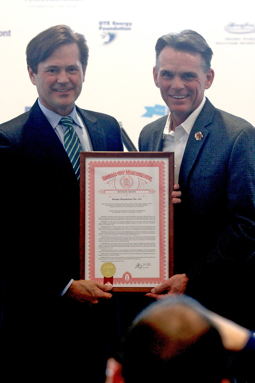 . Mark Hackel accepts a proclamation from the Michigan Senate presented by Steve Bieda.