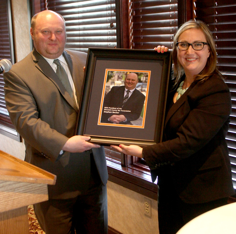 . Scommemortive presented to President teven Becker by Dawn Prokopec