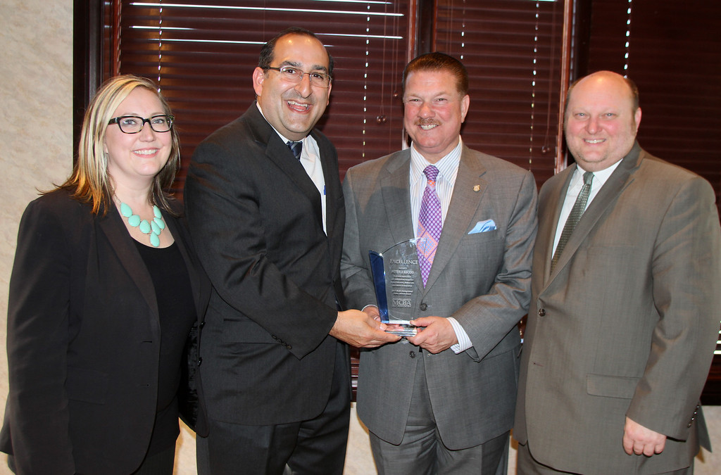 . Peter Lucido Presented the Public service award be David Viviano With Karen Trickery Papas amd president Steve Becker