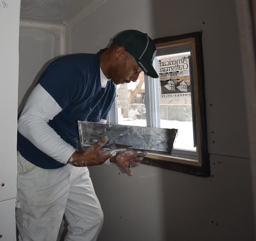 . One of many volunteers who worked to renovate a home that was donated to Habitat for a single mother with five children.