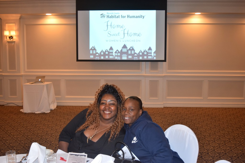 . April Chatman of Warren, a new homeowner and a longtime friend pose during the Women\'s Luncheon at Shelby Gardens. Chatman was among the guest speakers -- who inspired many people to support the mission of Macomb Habitat.