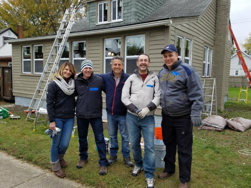 . Volunteers from the business community are among the people that helped to renovate a home for a single mother with five children. She and her kids moved in just before Christmas.