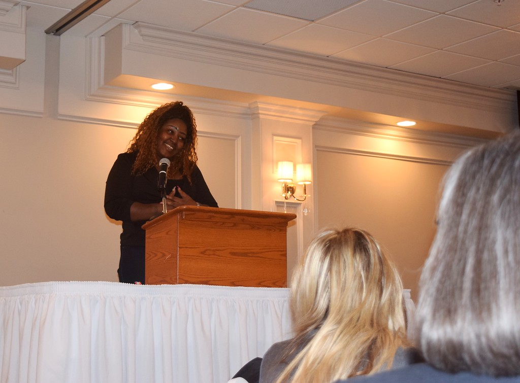 . April Chatman of Warren tells the crowd of people who turned out for Habitat\'s Women\'s Luncheon her amazing story and how she came to be a Habitat homeowner.