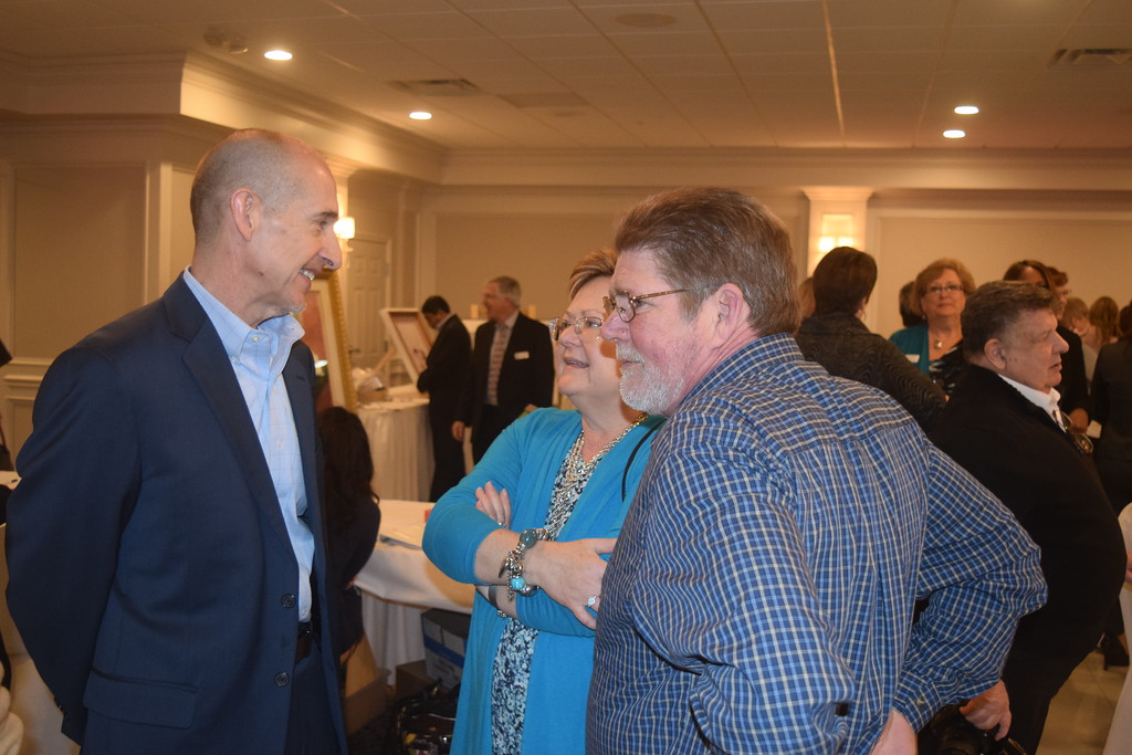 . Speaking with guests at the Macomb Habitat Women\'s Luncheon is Michael Meldrum, Habitat board member and co-owner of Complete Interactive Technologies in Clinton Township. CIT is among the corporations supporting Habitat\'s mission locally.