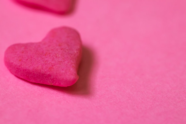 Macro Pink Candy Heart on a Pink Background