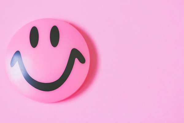 Macro Pink Smiley Face on a Pink Background