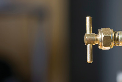 Tiny brass tap. Took this shot for work. Lots of space for text.