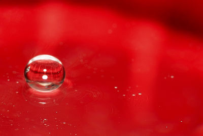 I slipped a red notebook under the clear glass bowl for this shot.