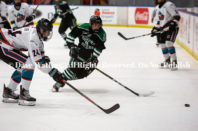 Okotoks Bow Mark Oilers Forward, Ivan Chtchadov carrying the puck agains Okanagan Rockets D, Jace Weir, in Game #4 of the Macs Tournament today at Max Bell.