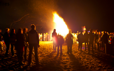 A crowd gathers around a large bonfire at Mad River County Park in this 2013-2014 photo. (Humboldt County Public Works Department - Contributed)
