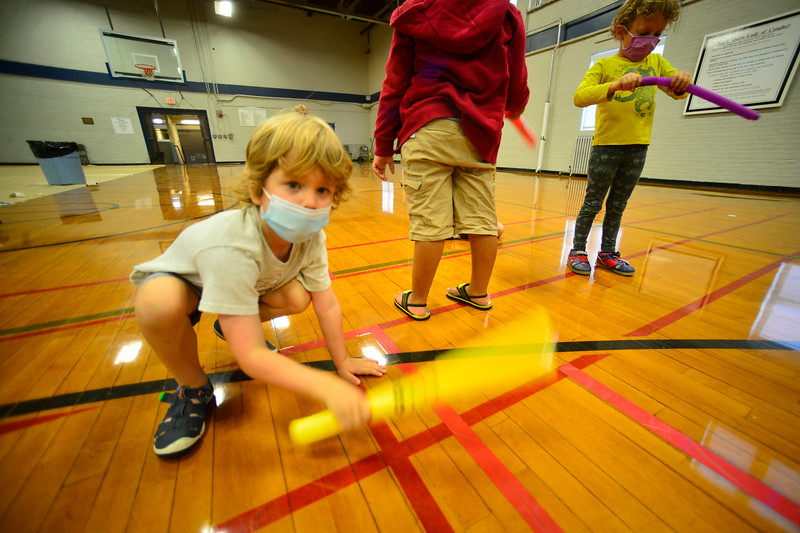 Charlie Savage bangs a music stick on the floor as part of the Mad Science Camp that was hosted by the Brattleboro Recreation & Parks Department at the Gibson Aiken Center third floor Gymnasium on Wednesday, July 21, 2021.