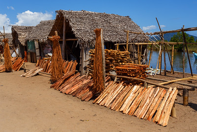 drying wood behind hut, Madagascar