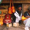 Men selling guitars, Antsirabe, Madagascar