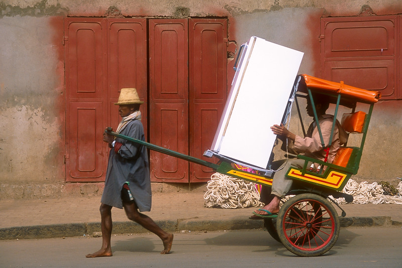 Pousse-pousse carrying refrigerator, Antsirabe, Madagascar