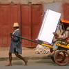 Pousse-pousse carrying refrigerator, Antsirabe, Madagascar