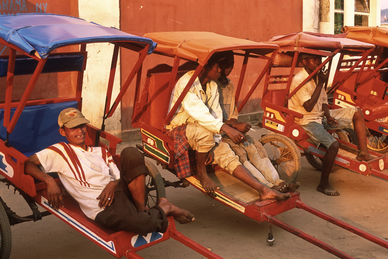 Pousse-pousse drivers wait for customers, Moramunga, Madagascar