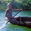 Boy paddles pirogue in Pangalanes Canal, Madagascar