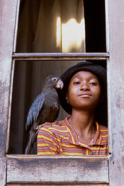 Girl and parrot, Fianarantsoa, Madagascar
