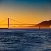 Cargo ship entering the San Francisco Bay on sunset