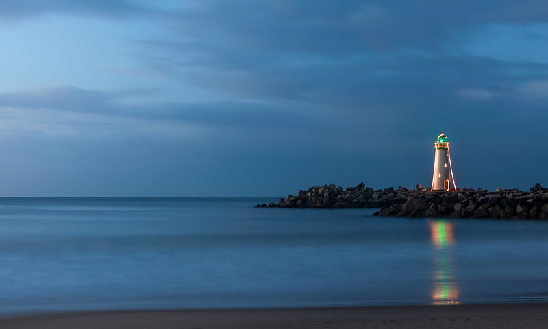 Walton Lighthouse with Christmas lights at sunrise v1