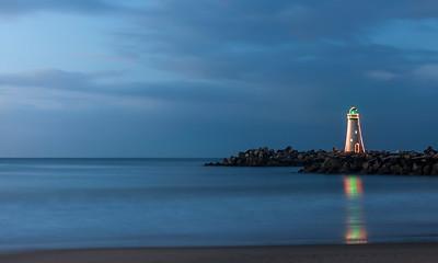 Walton Lighthouse with Christmas lights at sunrise v1