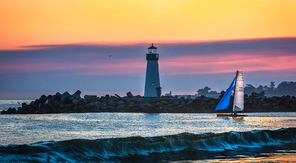 Two lighthouses, a boat and a wave...