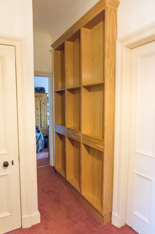 Narrow Oak veneered MDF bookcase with adjustable shelves