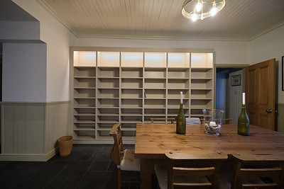 3.5m x 2.4m bookcase in painted birch ply with full adjustable shelves and concealed lighting