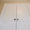 Vestibule cupboard doors.