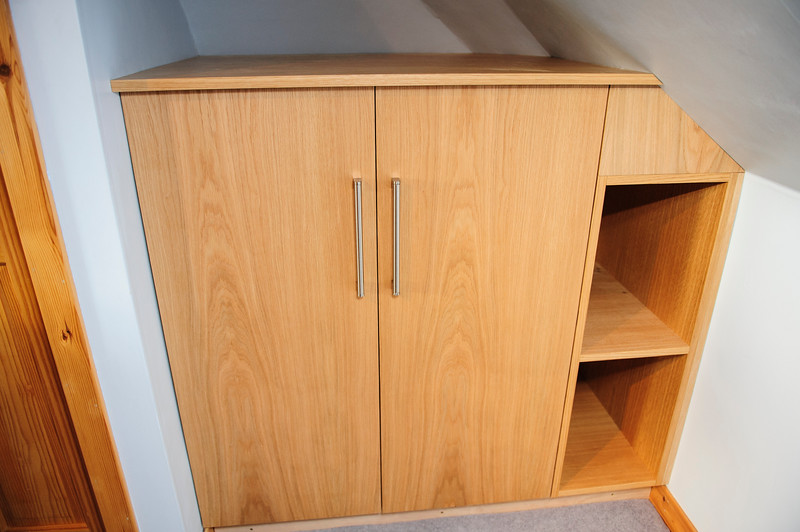 Oak veneered MDF wardrobes.