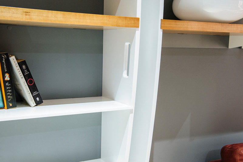 Bookcase made from hi gloss painted MDF with Acrylic and Cherry Shelves with concealed door opening into tunnel.