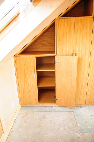 Oak veneered MDF wardrobes with triangular cubby holes