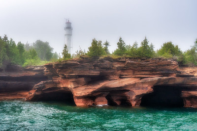 Sea Caves and Lighthouse in fog  on Devil's Island, Wisconsin