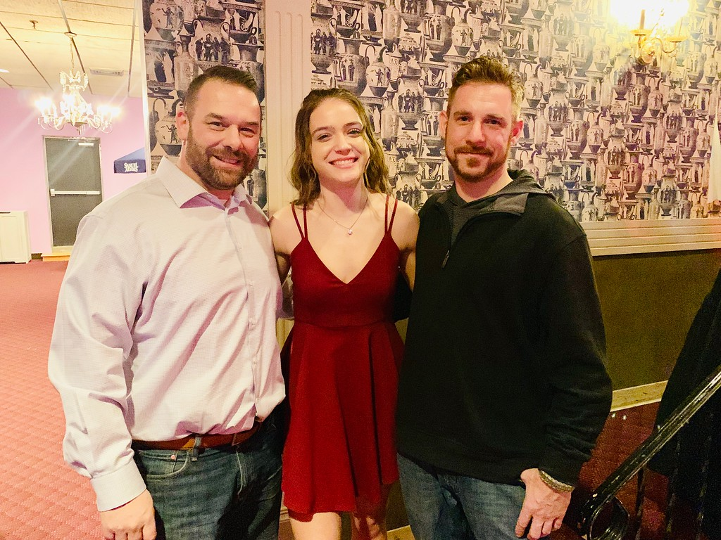 . Maddie with her uncles, Marine veterans Dave and Stephen Lavoie, all of Lowell