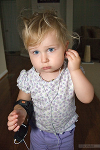 Everybody has an iPod.  Even crazy-haired toddlers.
