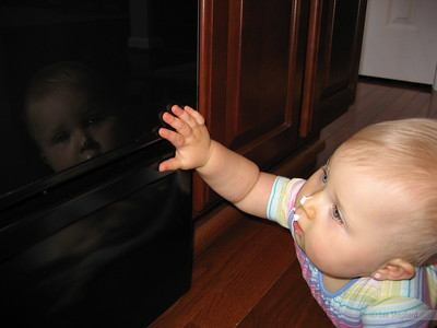 Mom!  That other baby from the mirror is in the oven now!
