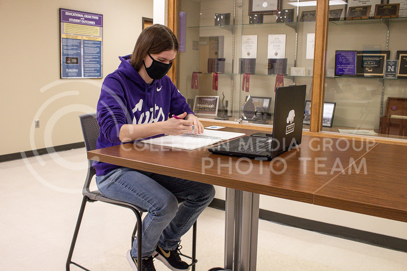 Madison Schoemann senior in Civil Engineering works on a project in Durland Hall. Civil engineers construct and maintain infrastructure projects. <br /> Photo by Macey Franko