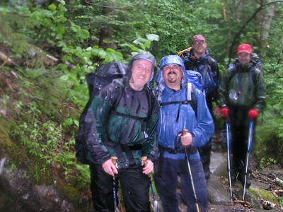 By now the weather had become adverse and dour. Our desire to reach Madison Springs Hut to get dry pushed us forward.