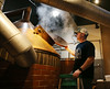 HOLLY PELCZYNSKI - BENNINGTON BANNER William Gardner, brewery manager at Madison Brewing Company Pub & Restaurant checks one of the barrels at the pub during brewing process on Thursday afternoon in Bennington.